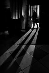 ... between ... (heinzkren) Tags: dark church door schwarzweis blackandwhite monochrome perchtoldsdorf shadow schatten light licht long woman human sony indoor advent old entrance bright silhouette lines candid street streetphotography cameraobscura innamoramento