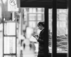 waiting for the bus (stevebanfield) Tags: streetphotography monochrome street woman bw sony blackandwhite seattle flickr