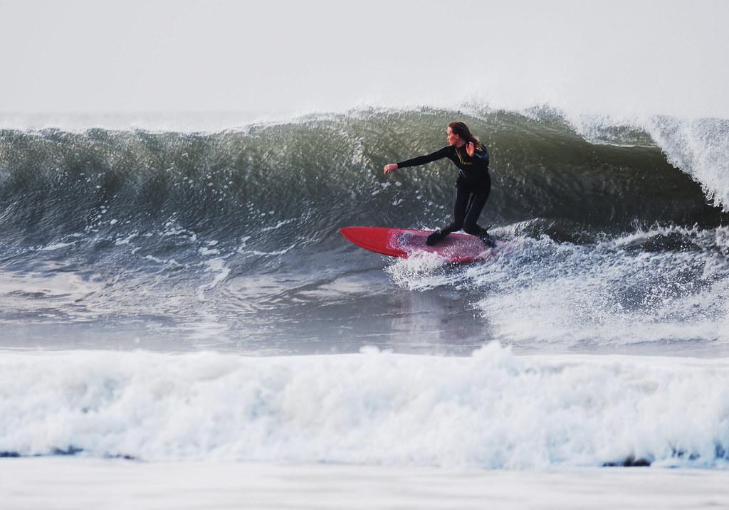 Surfer Girl Surfing Croyde Bay