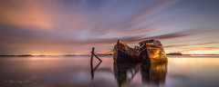 Alone Together (Bradley Grove) Tags: alone boat calm clouds decay moody old peace reflection solitude sunrise together water wooden wreck