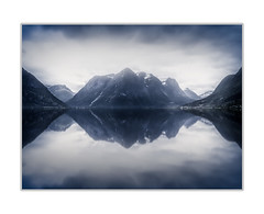 Mountainscape (andreassofus) Tags: mountain mountainscape mirror reflection reflections lake nature landscape sky clouds dramatic monochrome norway fineart fineartphotography outdoor water scandinavia longexposure lee bigstopper leebigstopper