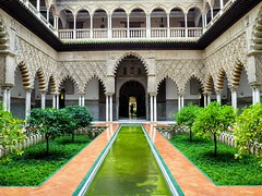 Reales Alcazares - Seville. (Flyingpast) Tags: realesalcazares seville andalucia spain spanish moorish architecture building ancient beautiful alcazar fortress palace water plaza renaissance islamic design patio garden