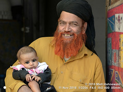 2015-03b Doubling Down on Doubles 2018 (10) (Matt Hahnewald) Tags: matthahnewaldphotography facingtheworld people character head face teeth expression fullbeard muslimbeard henna hennahairdye islamicbeard black turban amamah imamah consent respect parentalconsent concept humanity living culture tradition lifestyle love childhood fondness traditional cultural muslim islam imam grandfatherandchild grandfather udaipur rajasthan india indian rajasthani twopeople male baby elderly man photo detail physiognomy nikond610 nikkorafs85mmf18g 85mm 4x3ratio resized 1200x900pixels horizontal street portrait doubleportrait halflength closeup seveneighthsview indoor posing awesome authentic smiling happy holdingbaby clarity kohl kajal surma colour