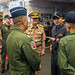 U.S. Navy Capt. Brian Mutty, commanding officer of the USS Essex speaks with officers of the Royal Thai navy