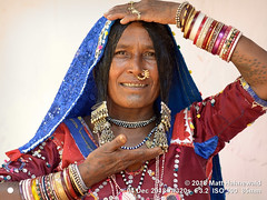 2018 Women (23b) (Matt Hahnewald) Tags: banjara lambadi gor gormati scheduledtribe matthahnewaldphotography facingtheworld people character face facialtattoo tattoo eyes nosejewelry jewelry silver expression hairstyle traditional clothing headscarf dupatta bodylanguage gesture bothhands consent fun respect concept humanity living travel culture tradition anthropology ethnic tribal photoshoot benaulim goa india indian gypsy lamani individual oneperson female elderly woman physiognomy nikond610 nikkorafs85mmf18g 85mm 4x3ratio resized 1200x900pixels horizontal portrait halflength closeup fullfaceview posingcamera smiling series 2of3 bangles dress ring clarity lookingatcamera colourful colour