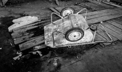 Oh Jack (MAKER Photography) Tags: bw black white monochrome greyscale single colour color wood plank dirt jack daniels glass bootle wheelbarrow abandoned smartphone phone oneplus germany munich paperfactory