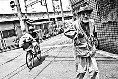Osaka Raw..... (Victor Borst) Tags: groen street streetphotography streetlife reallife real realpeople asia asian asians faces face candid travel travelling trip traveling urban urbanroots urbanjungle blackandwhite bw mono monotone monochrome mankind shinimamiya osaka osakaraw city cityscape citylife