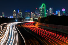 The Race Is On! (tquist24) Tags: dallas interstate30 nikon nikond5300 texas tomlandryfreeway city cityscape downtown freeway geotagged light lightstream lighttrails lights longexposure night sky skyline skyscraper skyscrapers traffic urban starburst