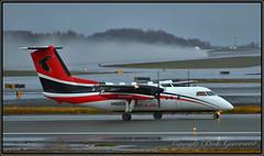 N892EA Ravn Alaska (Bob Garrard) Tags: n892ea ravn alaska de havilland canada dhc8 dash 8 anc panc rain wet