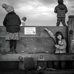 happy in a make believe.....grandaughter Margo, Whitstable. (stocks photography.) Tags: portrait michaelmarsh bw blackwhite photography photographer happyinamakebelieve whitstable coast seaside play beach