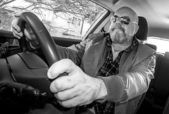 Driving posture. . . (CWhatPhotos) Tags: cwhatphotos mono monochromebw black white portrait inside art artisrtic self selfie olympus penf m zuiko 8mm prime lens f18 four thirds wide angle fisheye fish eye view digital camera photographs photograph pics pictures pic picture image images foto fotos photography artistic that have which with contain artistc light auto automobile car hyundai i20 12se 12 se vehicle 2017 new brand man male driver driving interior goatee hand flickr