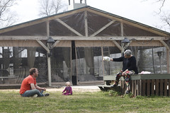 Slaughter holds out a toy to her granddaughter, Marin Hardy, while sitting with her son-in-law, Brian Hardy, outside of the inn. Slaughter's family often comes to the inn and brings their friends to visit.