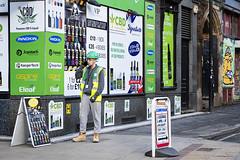 Green Coordination (Geoff France) Tags: street streetphotography urban city town manchester hardhat builder workman