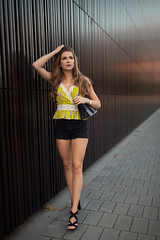 in the city (Michael Kremsler) Tags: model girl brunette longhair longlegs highheels bag hotpants portrait fashion streetfashion shooting public wall bokeh availablelight summer eveninglight woman