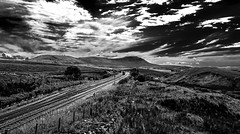 Blea Moor contre jour (Peter Leigh50) Tags: mono monochrome blackandwhite black white bw blea moor mountains hill fells train track railway railroad rural rail fujifilm fuji xt2 drs class 66 locomotive