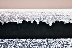 Breakwater. (pstone646) Tags: rocks sea bokeh nature reflection ramsgate kent sparkle sunshine sky horizon silhouette silhouettephotography
