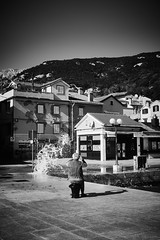 Waiting for the perfect wave (iamunclefester) Tags: baška vacation holiday croatia krk otokkrk blackandwhite monochrome sea water waves wave windy pier mole promenade waiting perfect sitting harbor harbour street wet old man photographer camera smartphone facade house hill mountains mountain lamp light castshadow hardshadow shadow village