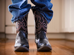 Sometimes in, sometimes out (amazed by cowboy boots) Tags: cowboyboot cowboy child clothing shoe boot jeans comfortable fashion wildwest littleboys hardwoodfloor lifestyles old