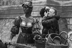 Choosing one's point of view .... (Frank Fullard) Tags: frankfullard fullard candid street portrait sculpture pov photography pointofview choice chose dublin mollymalone irish ireland lol fun monochrome black white blanc noir icon boobs metal