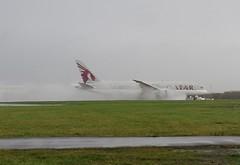 Photo of A7-BCI Wet landing.