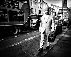 Mr White (Kieron Ellis) Tags: man walking suit white pavement bus traffic road street candid blackandwhite blackwhite monochrome