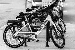 this machine was made for ridin' (fallsroad) Tags: sigma135 sigma135art tulsaoklahoma downtown city urban scene fragment blackandwhite bw monochrome bike bicycle bicycles public machine nikonsigma