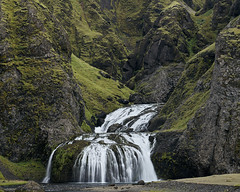 Stjornafoss (azhukau) Tags: stjornarfoss iceland travel outdoors waterfall flow stream water mountain creek flowingwater longexposure outside traveldestination nature rockobject green geology hill slope cascade