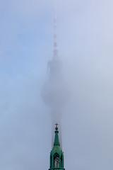 Berlin (Greg Carey) Tags: fernsehturm tower church spire cross mist germany stmarienkirche stmaryschurch evangelical fog cloud