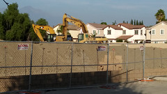 (Rich T. Par) Tags: pomona phillipsranch socal southerncalifornia losangelescounty lacounty constructionsite constructionvehicles california suburb sky field tractor dirt fence civilengineering parkinglot heavyequipment excavator bricks brickwall