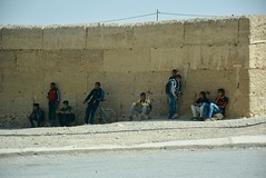 waiting in the shade for the bus (cam17) Tags: morocco sahara moroccansahara intheshade waitingintheshade busstop boysintheshade schoolboys