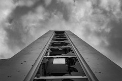 Towards The Sky Even though Shattered (panos_adgr) Tags: nikon d7200 architecture keratsini drapetsona attica greece building broken glasses abandoned sky clouds winter monochrome bw shattered