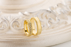Two gold wedding rings on beige background (Aleksa Torri) Tags: wedding rings background gold marriage white groom marry romantic bride accessories band bridal brilliant casual concept couple crystal design diamonds elegance fashion female gem gemstone gift jewel jewelery jewelry lifestyle luxury male nobody nuptial pair present two valentine wed woman textured advertisement macro closeup anniversary yellow golden ornament beige vintage