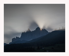 Surreal Sunrise (www.halkaphoto.com) Tags: europe italy funes villnös trentinoaltoadige südtirol stpeter sanpietro dolomites mountains alps sunrise rays geislergruppe theodlegroup clouds fog