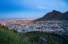 The lights are switching on.... (grannie annie taggs) Tags: capetown sundown city