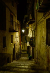 Cefalù at night (Tiigra) Tags: cefalù palermo italy it 2018 architecture balcony bike cefalu lantern laundry light medieval night passage rhythm road ruin sicily stairs town