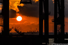 Today's Sunrise (Kumaravel) Tags: chennai bayofbengal chennaiport silhouette sunrise cycling crane containercrane sun clouds ship