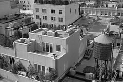 SoHo roof styles (colinpoe) Tags: 6x9 blackandwhite urbanlandscapekodakmedalist mediumformat soho urbanlandscape watertank medalistii rosenwachtank urban rosenwach nyc newyorkcity roof 620 medalist bw manhattan rangefinder rooftop