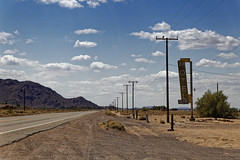 Along Route 66 in the Mojave desert (Guillaume DELEBARRE) Tags: motel california canon tamron2470f28 bagdadcafé landscape paysage usa america clouds cloudysky lonelyness repetition route66 66 desert désert poteaux