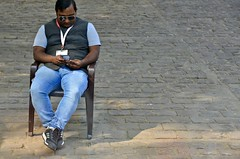 The Sit 'n' Wait (Pedestrian Photographer) Tags: fatehpuhr sikri tour guide plastic chair wait phone street jeans india