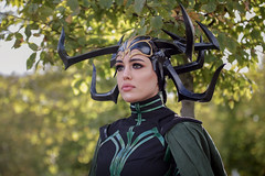 Hela cosplayer at ExCeL London's MCM Comic Con, October 2018 (Gordon.A) Tags: london docklands excel excellondonexhibitioncentre mcm moviecomicmedia comiccon con convention mcm2018 october 2018 creative costume horns style culture hela thor ragnarok marvelcomics character cosplay cosplayer cosplayphotography festival event eventphotography pretty lady woman face people model pose posed posing outdoor outdoors outside tree trees depthoffield dof bokeh day daylight naturallight portrait portraitphotography digital canon eos 750d sigma sigma50100mmf18dc
