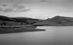 A628 Woodhead Road crosses Woodhead Reservoir (in drought) from TransPennine Trail rly footpath nr The Lodge Crowden Longendale (kyliepics) Tags: olympus e520 evolt520 olympuszuikodigital1122mmf2835 darktable blackwhite