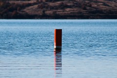 Floating buoy (katyearley) Tags: t6 rebel canon canonrebelt6 landscape floating buoy lake water waves white blue red depth reflection