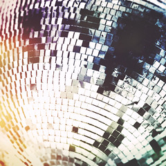 day 18 (Randomographer) Tags: project365 365 disco ball mirror glitter roughly spherical object facets mirrored surface illuminated beams light flashing nightclub dance ornament yellow blue curve 18 2019