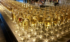 Glasses full of champagne at a bar (Jonatan Svensson Glad (Josve05a)) Tags: modern elegant party bottle drink alcohol glass night reflection liquid bubble composition fashionable luxury glasses photography service table christmas romance beverage dinner bar wine france lifestyles elegance crystal golden shiny anniversary hanging cocktail festive gold creativity banquet wineglass drinks bubbles champagne toast horizontal new arranging sparkle filling waiter bubbly wedding champagneglasses champagneflute drinkingglass prosecco weddingreception winebottle celebrate celebration concepts foodanddrinkindustry celebrationevent foodserviceoccupation closeup partysocialevent celebratorytoast glassmaterial champagneregion goldcolored whitecolor holidayevent multipleobjects