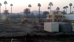 (Rich T. Par) Tags: pomona phillipsranch socal southerncalifornia losangelescounty lacounty constructionsite california palmtrees tree suburb dirt civilengineering sky frontloader tubes pipes dusk evening heavyequipment excavator sunset autumn grader storagebin cargocontainer lumber house forklift crane plywood architecture