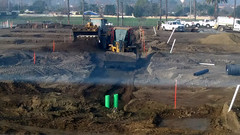 (Rich T. Par) Tags: pomona phillipsranch socal southerncalifornia losangelescounty lacounty constructionsite california palmtrees tree road suburb dirt civilengineering tubes pipes tractor frontloader heavyequipment watertruck civilengineers