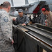 U.S., Japanese Airmen discuss differences in ammunition loading systems at Naha Air Base
