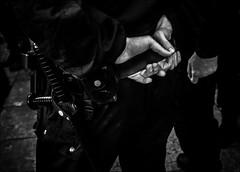 Une manifestation dans le calme... / Peaceful protest... (vedebe) Tags: main mains police manifestation ville city rue street urbain urban homme humain human people noiretblanc netb nb bw monochrome société