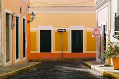 walking down the streets of old san juan (Sam Scholes) Tags: colorful color travel street puertorico architecture cobblestone vacation building orange sanjuan