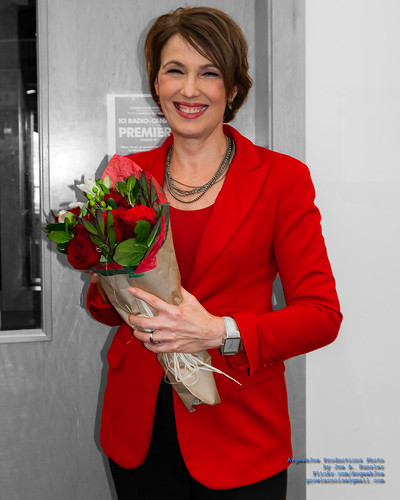 Gloria Macarenko With Whole Foods Bouquet in the Red Filter